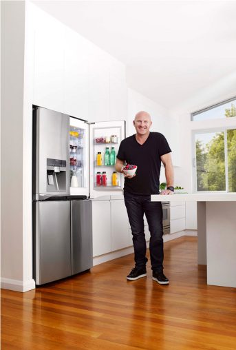 Restaurateur Matt Moran with some fresh berries and an LG Door-in-Door fridge.